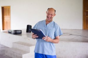 Mission co-director Dan Hans [Second Church Pastor giving daily work assignments