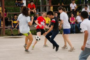 Second Church member Anne Evans playing soccer for R&R after a day in the clinic